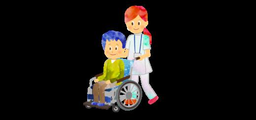 男性の乗った車椅子を押す理学療法士